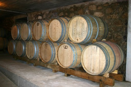 Oak barrels in the cellars of Xavier Alexandre